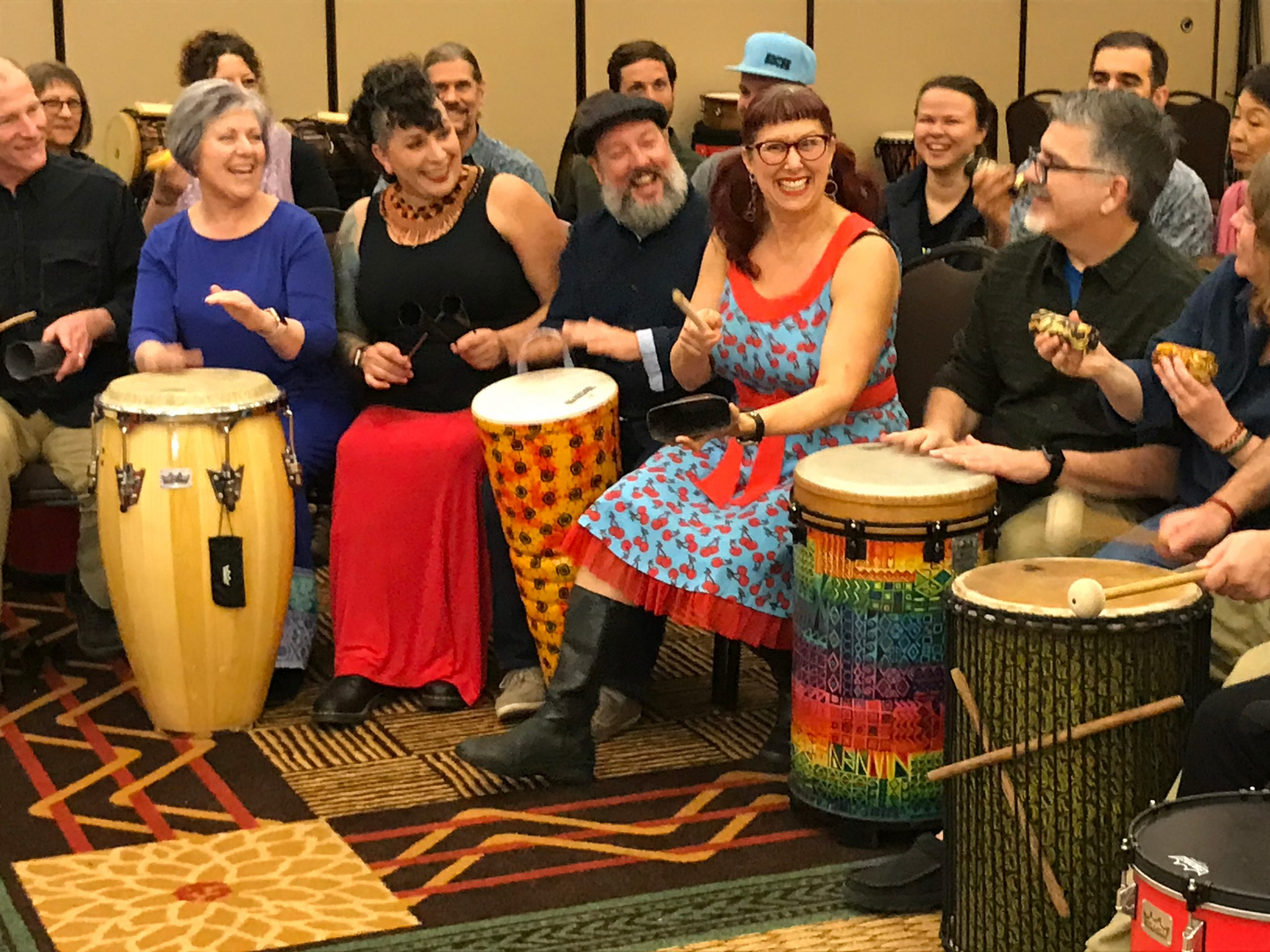 group of people drumming in circle
