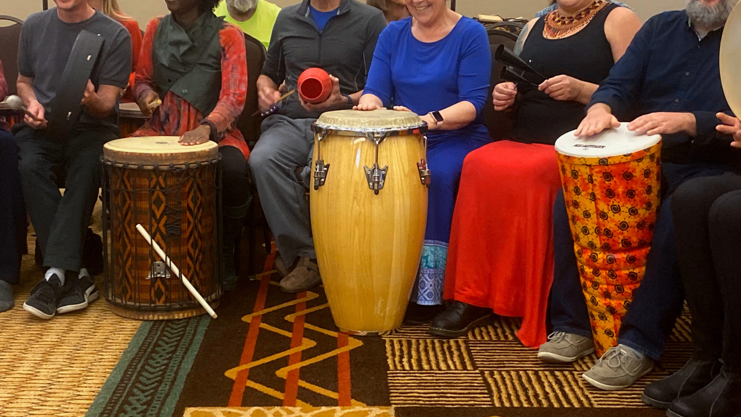 group of people drumming instruments