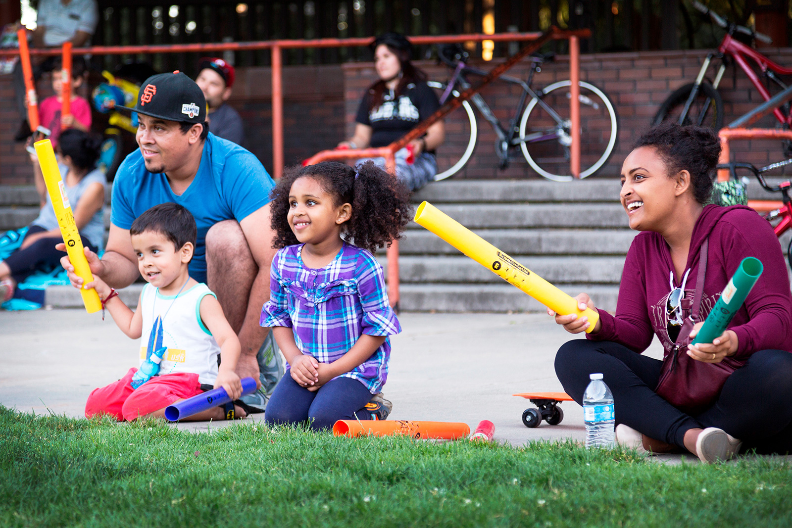 kids with parents in grass boomwhackers