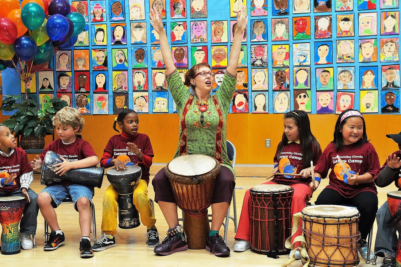 jeni arms up students drum circle